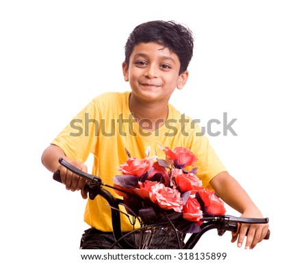 Boy playing bicycle isolated on white background Mumbai Maharashtra, India, South East Asia.
