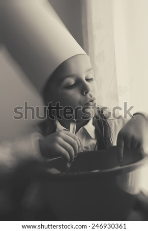 boy playing chef black and white photography - stock photo