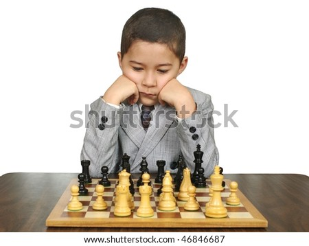 Boy Playing Chess - stock photo