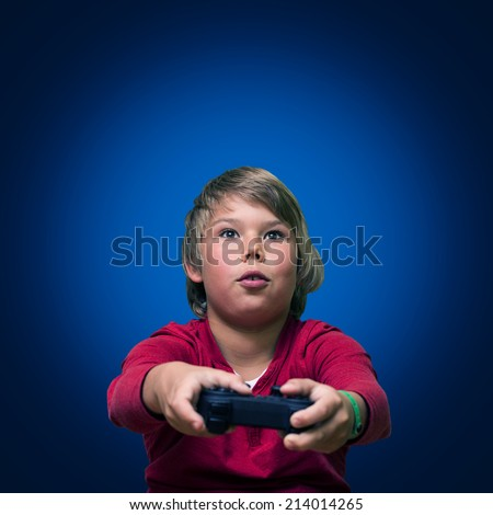 Boy playing computer games. - stock photo