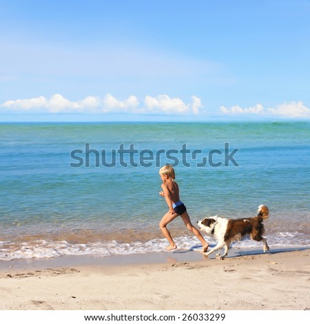 boy playing dog on the sea