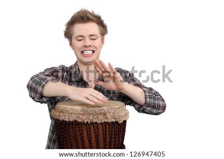 Boy playing drum - stock photo