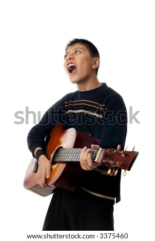 Boy playing guitar and singing a rock song - stock photo