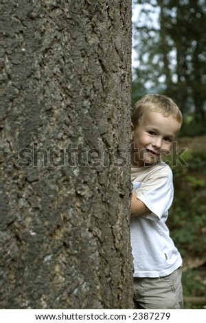Boy playing hide and seek.