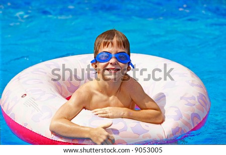 Boy Playing in Pool - stock photo