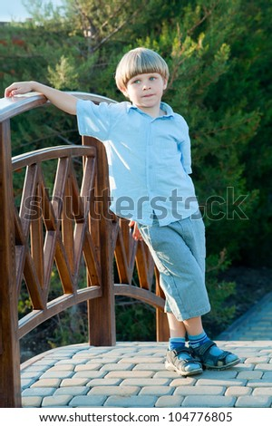 Boy playing in the park - stock photo