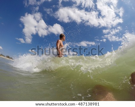 boy playing in the sea waves