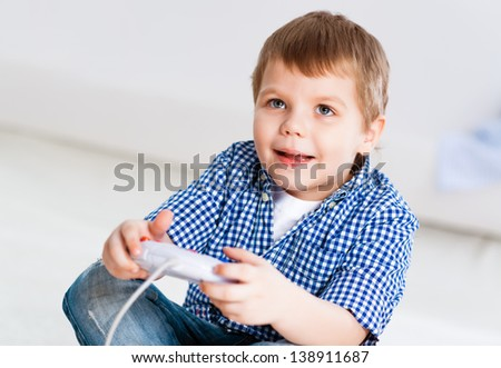 Boy playing on a game console, have fun
