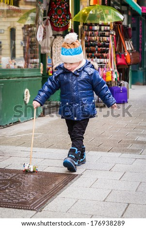 Boy playing on the street - stock photo