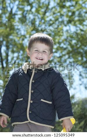 Boy Playing Outside - stock photo