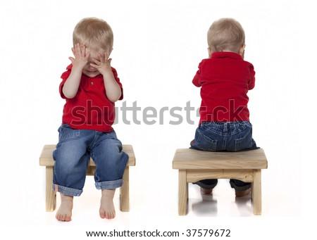 Boy Playing Peek a Boo - stock photo