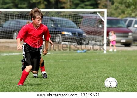 Boy playing soccer - stock photo