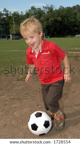 Boy playing soccer - stock photo