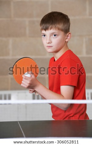 Boy Playing Table Tennis In School Gym - stock photo