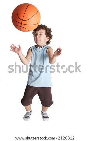 boy playing the basketball with white bottom that almost receives a blow from a ball