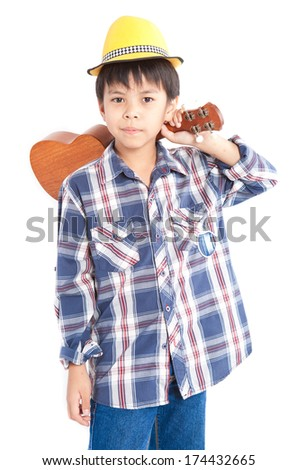 Boy playing the ukulele on white background.