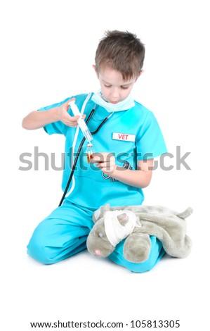Boy playing the veterinary surgeon. - stock photo