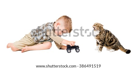 Boy playing toy car together with cat isolated on white background - stock photo
