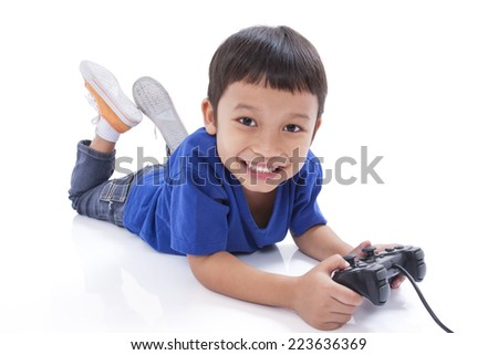 Boy playing video game and lying on the floor