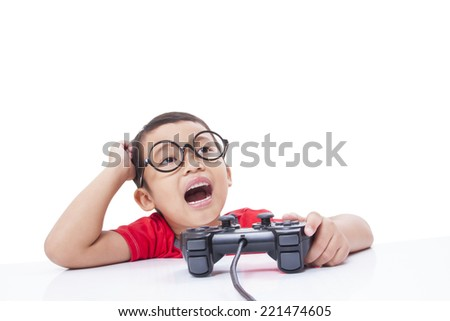 Boy playing video game with glasses.  - stock photo