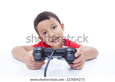 Boy playing video game with glasses