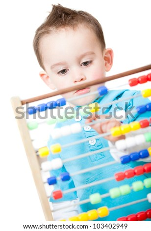 Boy playing with an abacus - isolated over a white background - stock photo