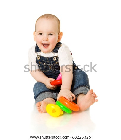 boy playing with colorful pyramid toy isolated on white - stock photo