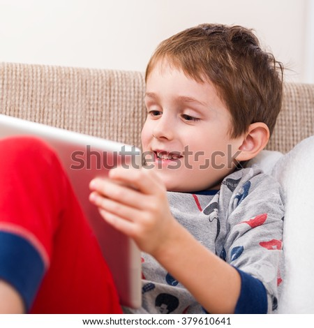 boy playing with digital tablet