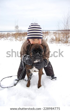 Boy playing with dog - stock photo