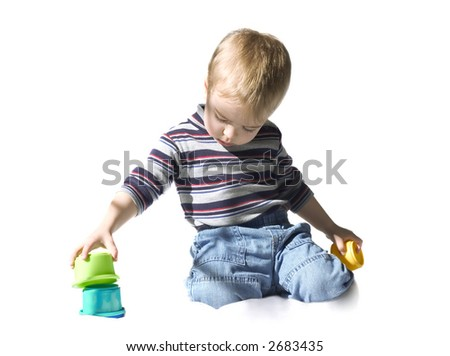 Boy playing with educational toys over white