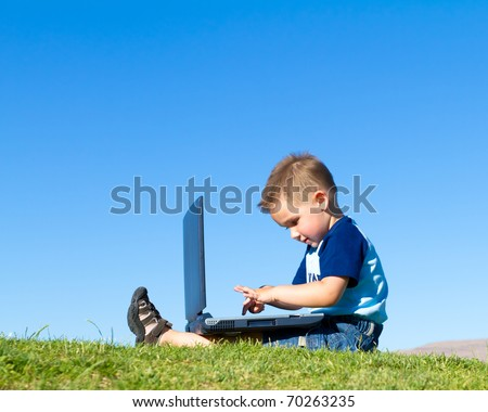 boy playing with laptop - stock photo