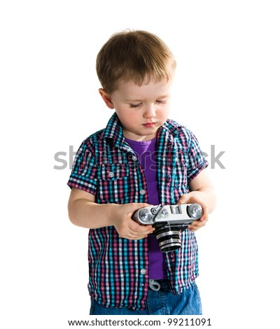 Boy playing with photo camera -  isolated on white background