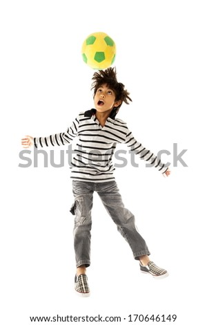 Boy playing with soccer ball  - stock photo