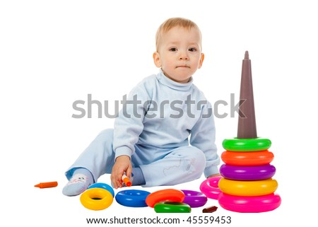 boy playing with the educational toy isolated on white background