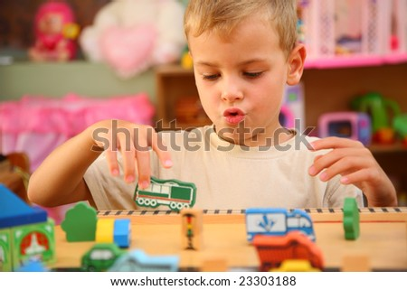 Boy plays  in playroom - stock photo
