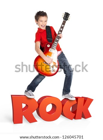 Boy plays  on electric guitar. The boy stands on the word of the rock from the 3d text - isolated on white background - stock photo