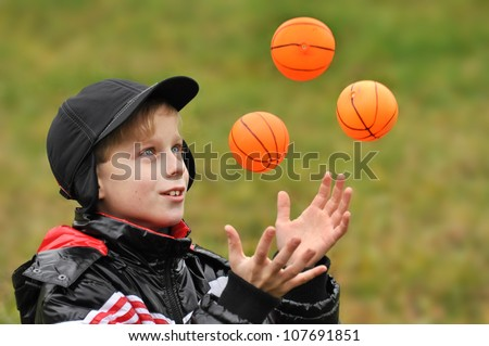 Boy plays with balls