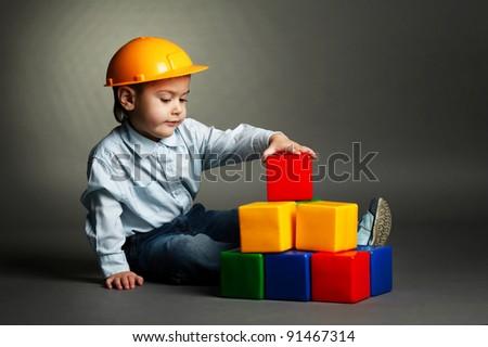 boy  plays with blocks - stock photo