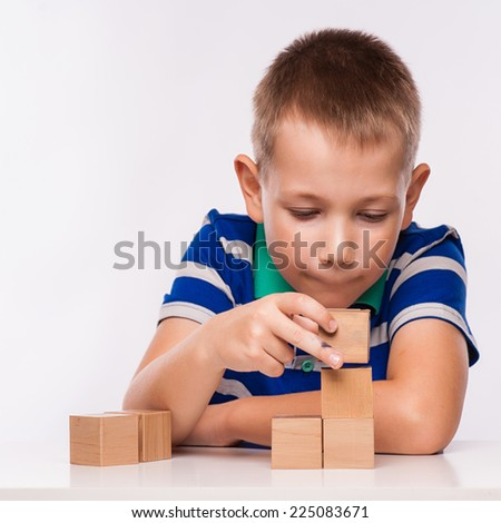 boy plays with cubes - stock photo