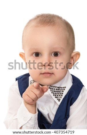 Boy pointing at camera with his finger - stock photo