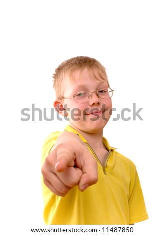 Boy pointing his finger right at you. Isolated on white. - stock photo