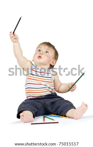 Boy pointing with color pencils - stock photo