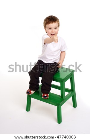 Boy pointing with his finger - stock photo