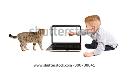 Boy points finger at the screen of laptop, sitting with a cat isolated on white background - stock photo