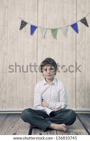 Boy portrait in a studio - stock photo