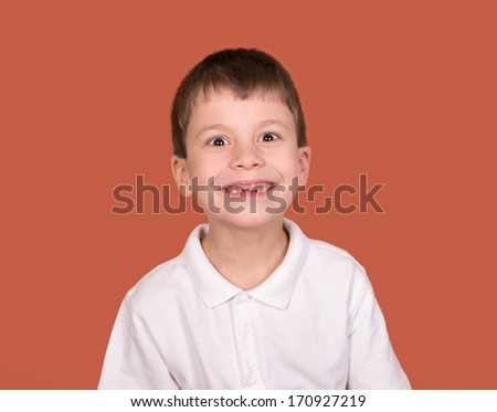 boy portrait in white shirt on brown