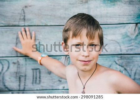 Boy portrait outdoor at countryside during vacations - stock photo