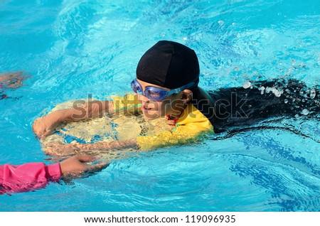 Boy Practice Swimming - stock photo