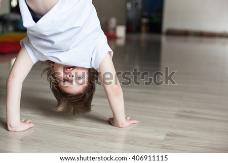 boy practicing capoeira (brazilian martial art that combines elements of dance, acrobatics and music), handstand
