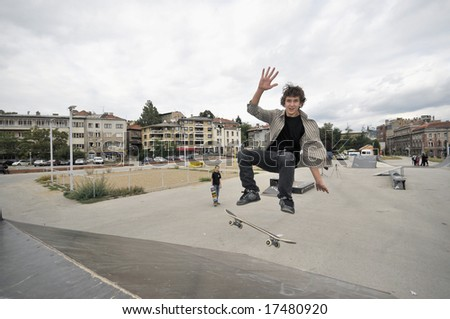 Boy practicing skate in a skate park - stock photo